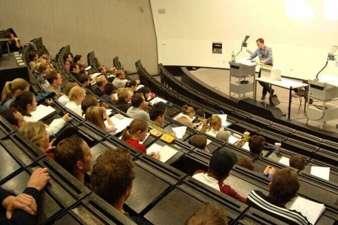 Picture of a lecture hall with students.