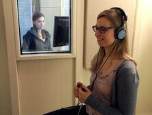 A test person carries out a hearing test