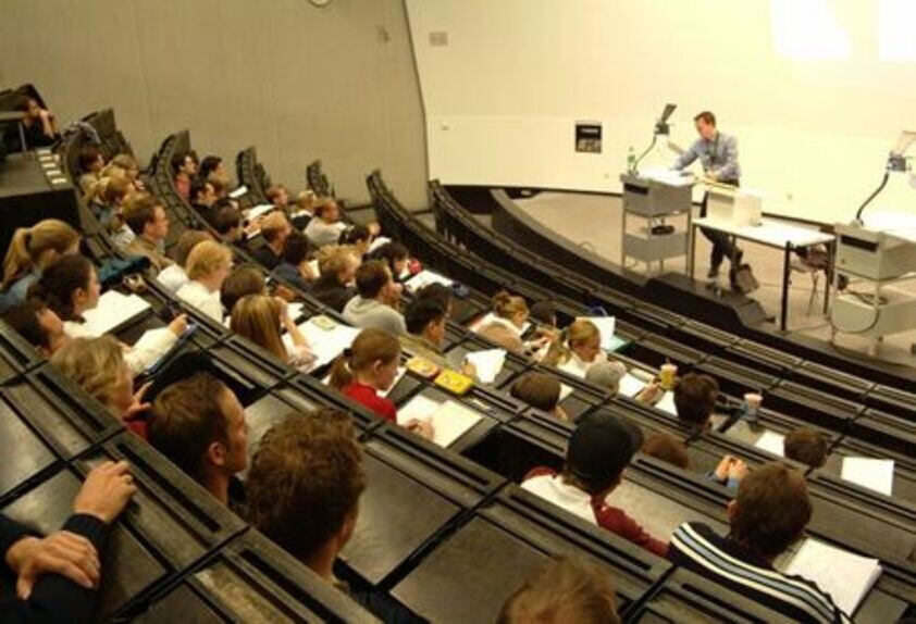 Picture of students in a lecture hall.